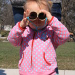 Photo of a girl holding binoculars