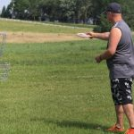 Photo of man playing disc golf