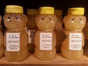 Photo of bear bottles of honey