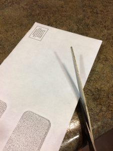 Photo of scissors on an envelope