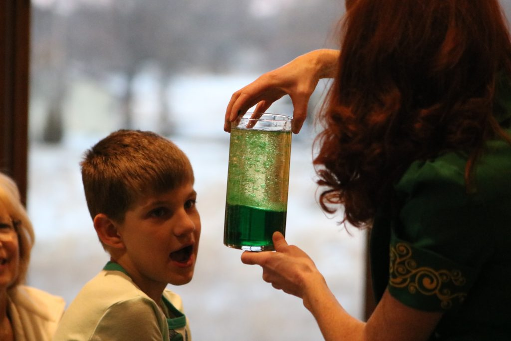 Photo of a kid looking at a homemade lava lamp