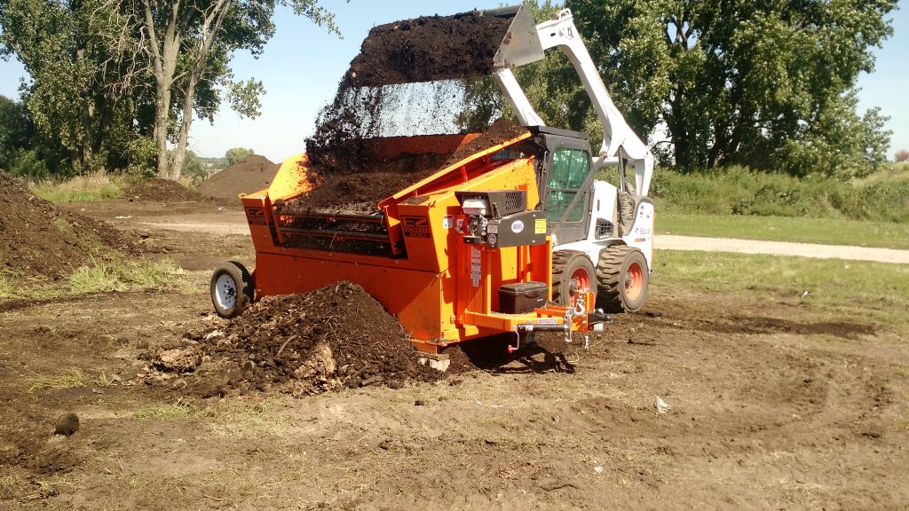 Photo of compost being sifted