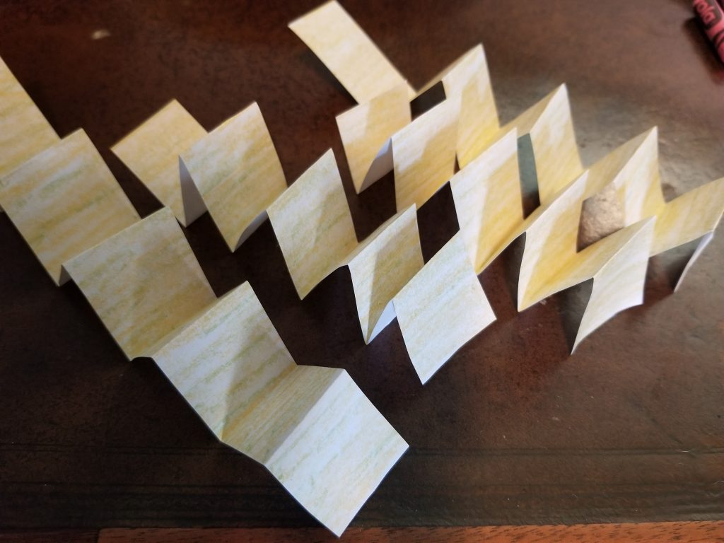 Photo of accordion strips of paper